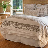 Lili Alessandra Christian collection of white linen with platinum velvet pillows.