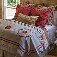 Lili Alessandra Barcelona collection of stone linen with cinnabar and straw velvet applique pillows.