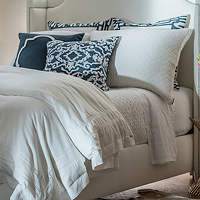 This new bedding collection features Casablanca duvet and pillow with a white linen finish with white linen applique.