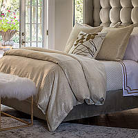 Accentuate your bedroom with Lili Alessandra's Sophia duvet and pillows with a rich gold lurex textured finish and other pieces.