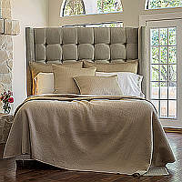 Retro quilted coverlet and  pillows complete a luxurious collection that is modern, crisp and clean.