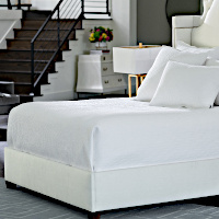 Coverlet and pillows are made with channel-quilted White Cotton.