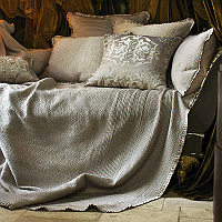 This Taupe colored bedspread has unique quilted lines on top that go from front to back with contrasting lines that go across the sides.