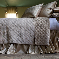 Chloe Champagne quilted coverlet, pillows and Chloe Gathered Champagne bed skirt with eye catching Paris pillows complete a luxurious collection that will enhance any bedroom.
