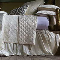 Chloe Ivory quilted coverlet and pillows combined with eye-catching Zebra decorative pillows complete a luxurious collection that will enhance any bedroom.