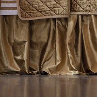 Displayed bed skirts are made with unique fabrics that are smooth and luxurious.