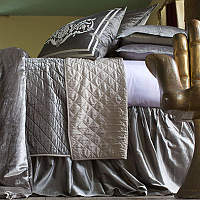 Chloe Silver quilted coverlet and pillows with eye catching Paris pillows complete a luxurious collection that will enhance any bedroom.