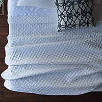 Emily White diamond quilted coverlet and pillows complete a luxurious collection that will enhance any bedroom.