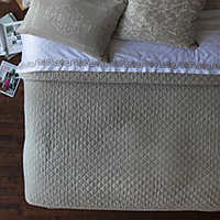 Emily Stone diamond quilted coverlet and pillows complete a luxurious collection that will enhance any bedroom.