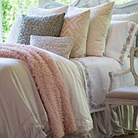 An old Hollywood ensemble of Lili Alessandra duvets, coverlets, pillows, throw, bed skirt, and sheets create this romantic yet modern luxury bedding
