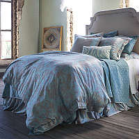 A bed dressed in tantalizing Silk and Sensibility has the look and feel of silk but is made of 100% polyester.