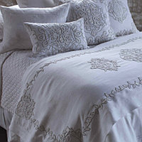 This exquisite bedding with intricate applique will bring a refined touch to any bedroom.