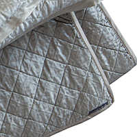 Chloe Ice Silver quilted coverlet, pillows and Chloe Gathered Ice Silver bed skirt complete a luxurious collection that will enhance any bedroom.