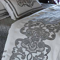 Poetry in motion, elegant designed pillow and throw.