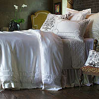 Duvets embellished with velvet applique create an understated luxury.