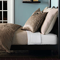 Nancy Koltes Manhattan bedding ensemble featuring Acanthus Latte duvet.