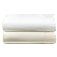 Peacock Alley Overture cotton percale bed sheets with large scalloped detail.