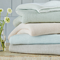 Throws have a woven narrow textured vertical stripe in 2 complementary tones that reverse to the same contrasting colors with a 12-inch contrasting band at top and bottom.