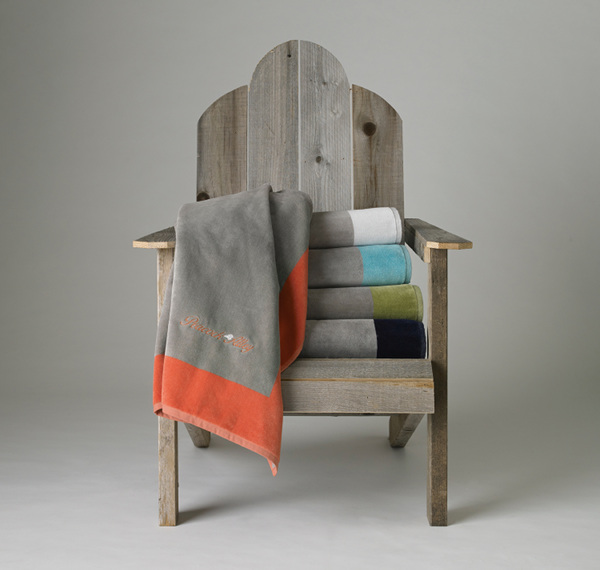 Peacock Alley Soleil Beach Towels - towels draped on chair.