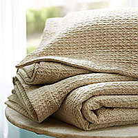 A softly textured, all-natural cover is the perfect weight for year-round comfort.