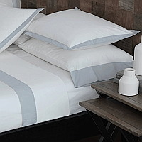 RB Casa Colorado solid white percale bedding with applied contrast border.