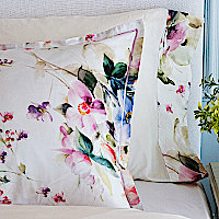Printed sateen cotton bedding with a plethora of beautiful flowers.