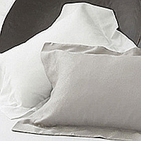 A small scale, crackled glaze pattern shows the reflection of light on this soft and silky fabric.