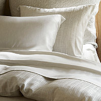 Silky Legna woven with a Melange technique to create a subtle heathered look behind the contemporary jacquard pattern.