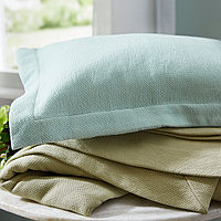 This washable cotton cover combines simplicity and sophistication.