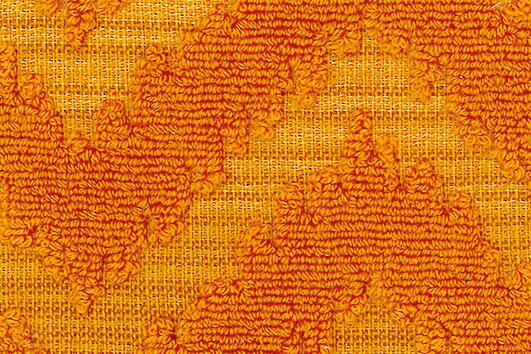 Svad Dondi India Bath Towels fabric closeup in Amber color.