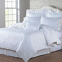 Bellini sheeting features tossed feathers on Italian sheeting.