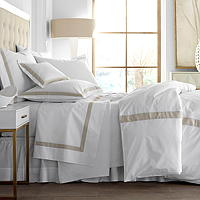 Eduardo sheeting features a band of linen inset on Traditions Linens's Italian sheeting.