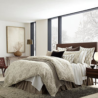 Classic and cool bedding ensemble in brown and white.