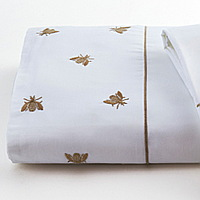 Mel sheeting features embroidered honeybees on Traditions Linens Italian sheeting.