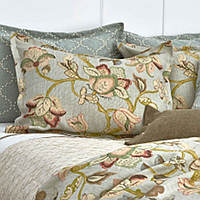 Traditions Linens's Luca Bedding is a collage of flowered pieces with quilted and applique pieces.