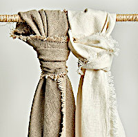 100% linen stone washed throws featuring raw edge with hemstitch.