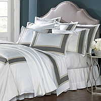Vienna sheeting features an application of black and taupe herringbone trim on Traditions Linens's Italian sheeting.