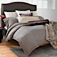 Wildcat Territory Earth Bedding Collection features Mud Linen Duvet with 1 inch Flange and Bronze Faux Leather Piping.
